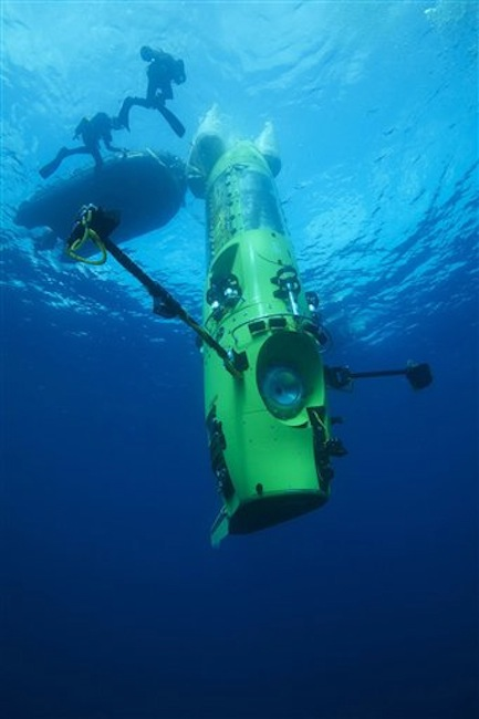 This February 2012 photo provided by National Geographic shows the DEEPSEA CHALLENGER submersible on its first test dive off the coast of Papua New Guinea. Director James Cameron used the vertical submarine to visit Earth's deepest point, seven miles below the surface. (AP Photo/Mark Thiessen, National Geographic)