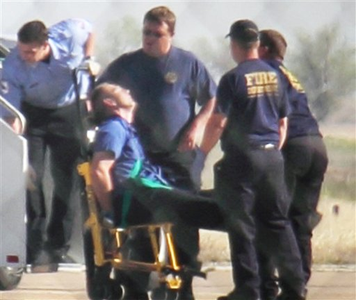 """Emergency workers tend to a JetBlue captain that had a """"medical situation"""" during a Las Vegas-bound flight from JFK International airport, Tuesday, March 27, 2012, in Amarillo, Texas. Passengers said the pilot screamed that Iraq or Afghanistan had planted a bomb on the flight, was locked out of the cockpit, and then tackled and restrained by passengers. (AP Photo/Steve Douglas)"""