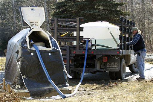 Ray Kemble pumps fresh water from a truck into his neighbor's holding tank in Dimock, Pa., in this Feb. 13, 2012, photo. The EPA is conducting water tests amid reports of drilling-related water contamination in several Pennsylvania communities.