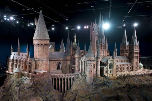 A model of Hogwarts castle from the Harry Potter film series is unveiled at the Warner Bros Studio Tour, Watford, London, Thursday, March 1, 2012. The Hogwarts castle model was built for the first film 'Harry Potter and the Philosopher's Stone', it was created for aerial photography and was digitally scanned for CGI scenes. It took 86 artists and crew members to construct, it measures over 50 feet in diameter and has over 2,500 fibre optic lights. (AP Photo/Jonathan Short)