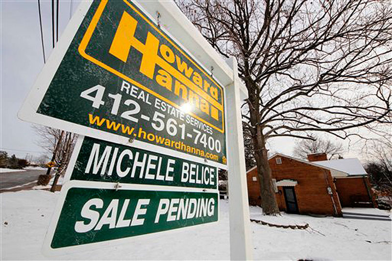 This Jan. 20, 2012 photo shows a home with a sale pending sign, in Mount Lebanon, Pa. The number of Americans who signed contracts to buy homes rose in January to the highest level in nearly two years, supporting the view that the housing market is gradually coming back. (AP Photo/Gene J. Puskar)
