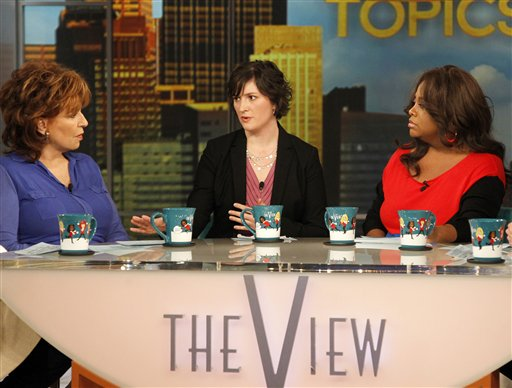 Georgetown University law student and activist Sandra Fluke, center, speaks as co-hosts Joy Behar, left, and Sherri Shepherd listen during an appearance on the daytime talk show