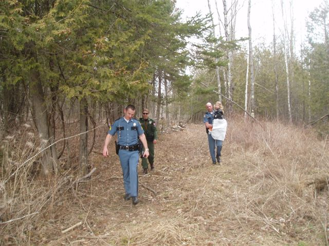 Searchers who found Morgan Lawler return her to her home this afternoon.