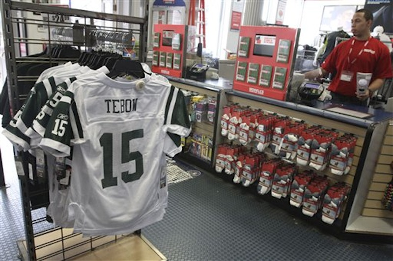 New York Jets football jerseys with the name and number of their new quartback Tim Tebow are on display at a Modell's store on Friday, March 23, 2012 in New York. Tebow was traded Wednesday, March 21, 2012, to the Jets from the Denver Broncos. (AP Photo/Mary Altaffer)