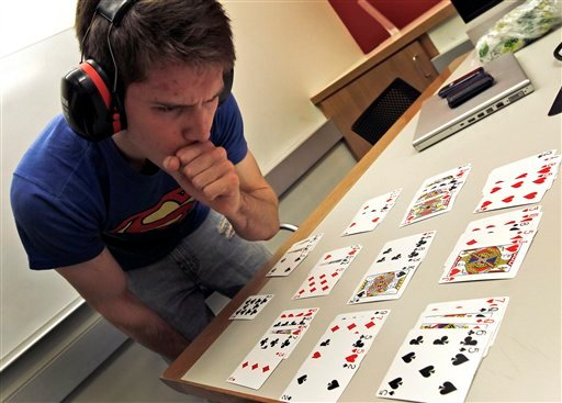 University of Pennsylvania sophomore Mike Mirski,19, wears sound dampening ear muffs as he practices his memory techniques ahead of Saturday's competition.