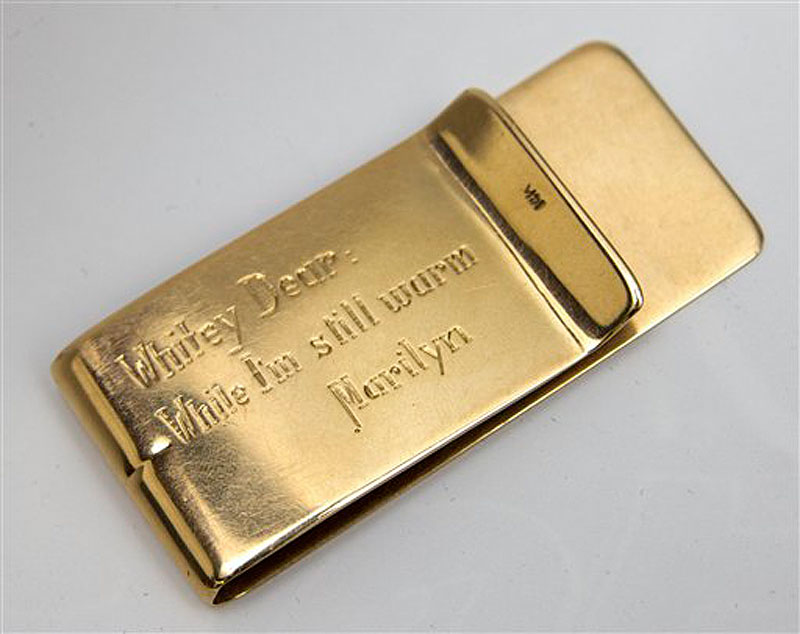 This undated image released by Julien's Auctions, shows a Tiffany Money Clip, stamped 14K gifted to Allan