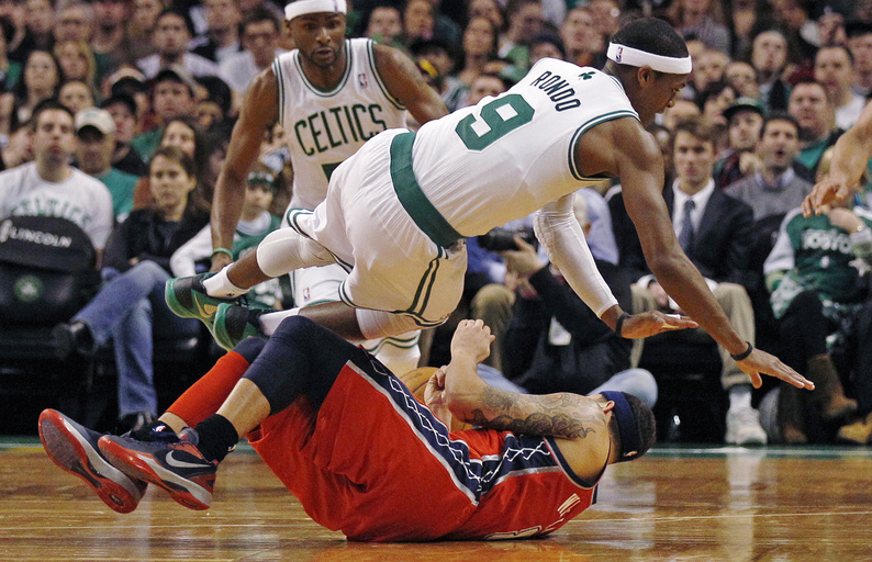 Celtics guard Rajon Rondo collides with Nets guard Deron Williams during Friday night's game in Boston. The Celtics won, 107-94.