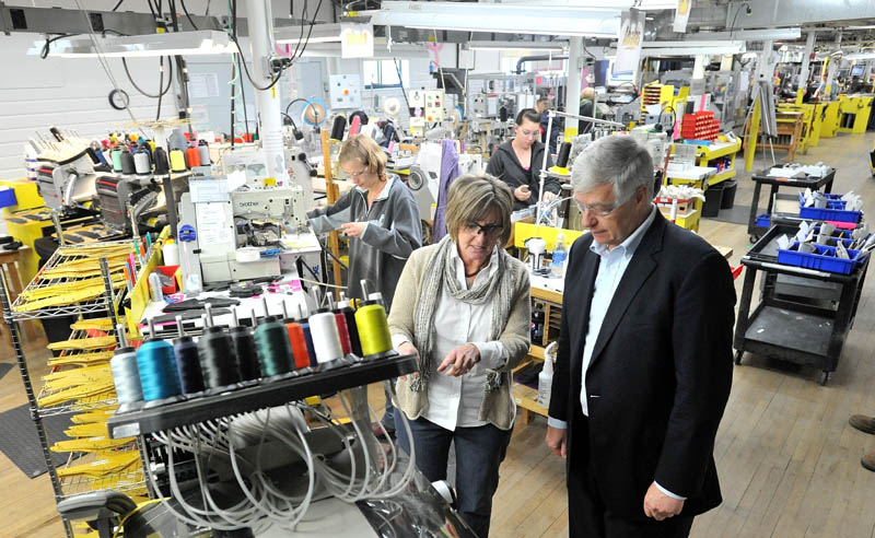 New Balance plant manager, Raye Wentworth, center, gives a tour of the factory to Rep. Mike Michaud this morning.