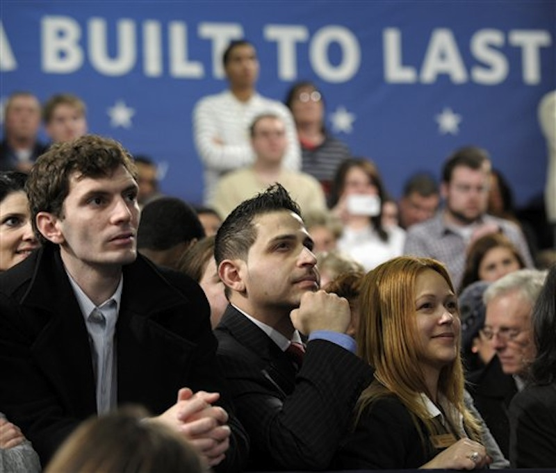 People listens as President Barack Obama speaks about his blueprint for an economy built to last with a focus on American energy, Thursday, March 1, 2012, at Nashua Community College, in Nashua, N.H. (AP Photo/Susan Walsh)