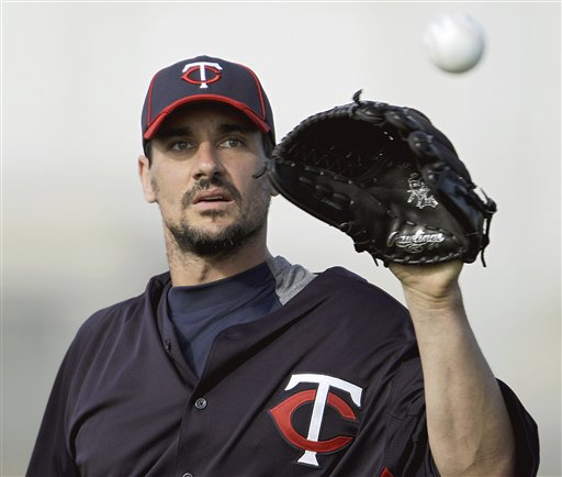 Minnesota Twins pitcher Carl Pavano works out during baseball spring training in Fort Myers, Fla., in this Feb. 21, 2012, photo.