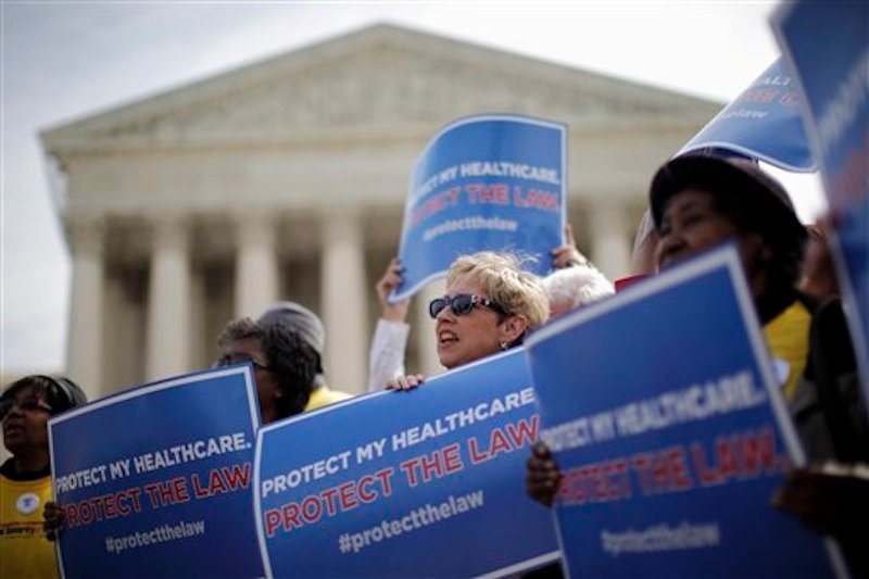 Supporters of health-care reform rally in front of the Supreme Court in Washington on Wednesday, March 28, 2012, on the final day of arguments regarding the health care law signed by President Barack Obama. (AP Photo/Charles Dharapak)