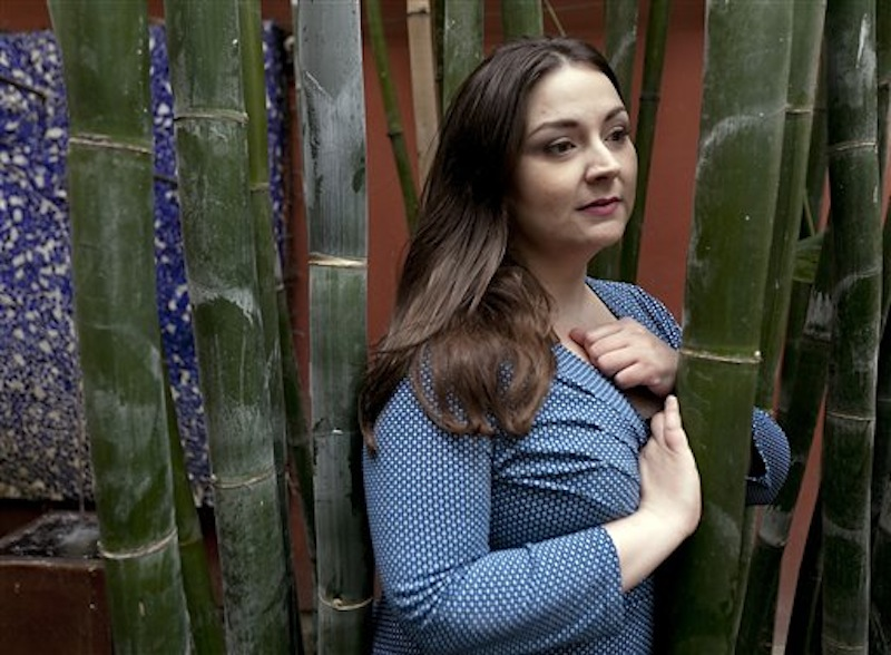In this March 1, 2012 photo, rape survivor Helena Lazaro poses for a photo in Glendale, Calif. For seven years, Lazaro believed the man who had violated not just her body at knifepoint, but also her psyche, was free to carry out a threat to kill her and her family if she reported the attack. But, he had been arrested and released, as DNA collected impersonally from the most intimate parts of her body sat untested with thousands of other rape kits in a police storeroom instead of being entered into an FBI database. (AP Photo/Damian Dovarganes)
