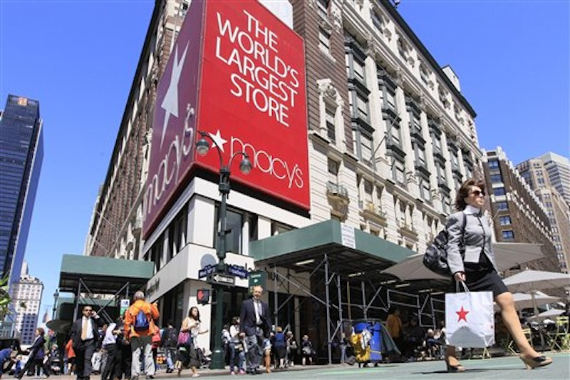 In this May 2011 photo, people carrying Macy's shopping bags walk past the Macy's flagship store, in New York. Macy's Inc., which runs Bloomingdale's and its namesake stores, said Thursday that February revenue at stores open at least a year climbed 4.6 percent to top analysts' estimates. (AP Photo/Mary Altaffer)