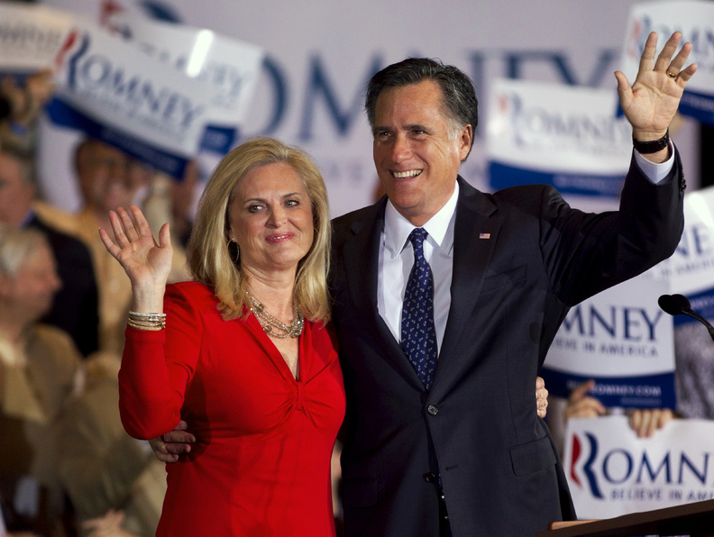 Republican presidential candidate, former Massachusetts Gov. Mitt Romney and his wife Ann wave to a crowd during a election night rally in Schaumburg, Ill., tonight.