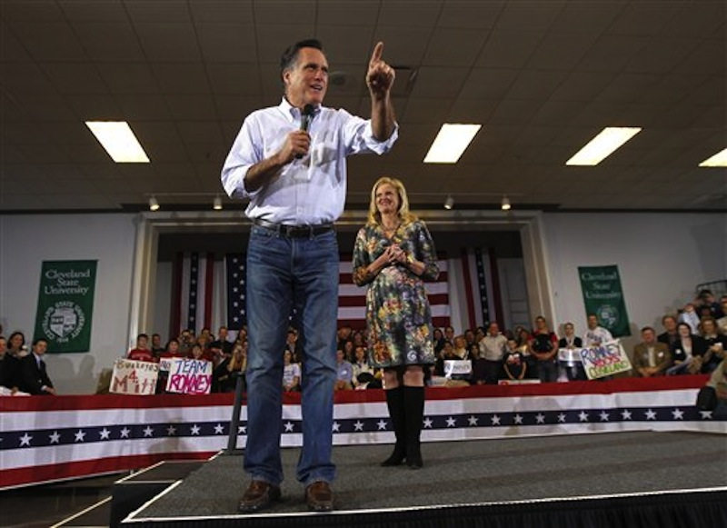 Republican presidential candidate Mitt Romney speaks with his wife, Ann, at a campaign rally in Cleveland, Friday, March 2, 2012. (AP Photo/Gerald Herbert)