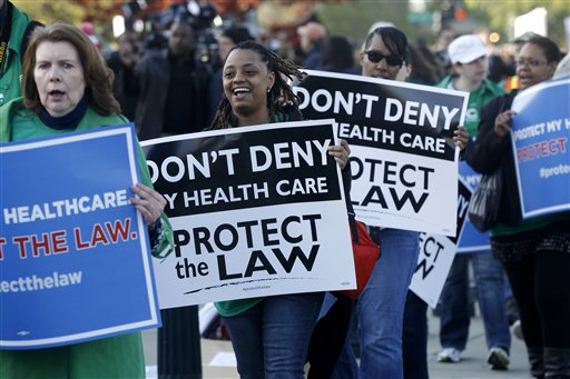 Supporters of the health care reform law signed by President Obama gather in front of the Supreme Court in Washington today, as the court begins three days of arguments on health care.