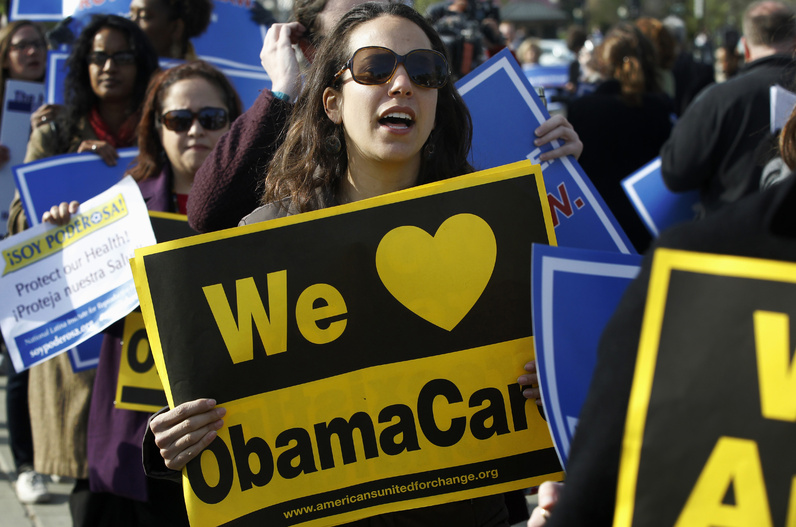 Supporters of health care reform demonstrate in front of the Supreme Court in Washington on Wednesday.