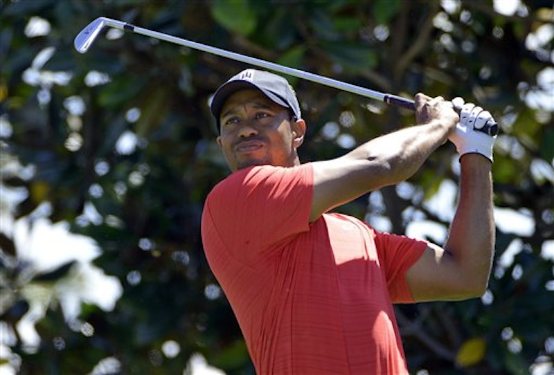 Tiger Woods hits from the second tee during the final round of the Arnold Palmer Invitational golf tournament at Bay Hill on Sunday, March 25, 2012, in Orlando, Fla. After 30 months, Woods is a winner once again. (AP Photo/Phelan M. Ebenhack)