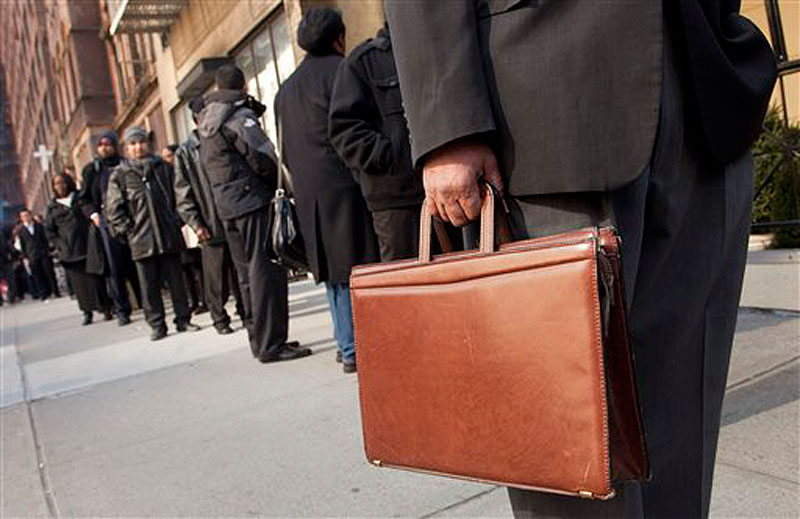 Dozens of job seekers line up to enter a National Career Fair on Wednesday, Feb. 22, 2012 in New York. The number of people seeking unemployment aid stayed at a four-year low last week, the latest evidence that layoffs are low and the job market is slowly healing. (AP Photo/Mark Lennihan)