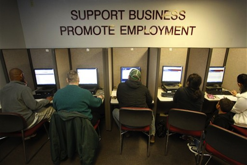Job seekers look for jobs at WorkSource Oregon Monday, Feb. 28, 2012, in Salem, Ore. (AP Photo/Rick Bowmer)