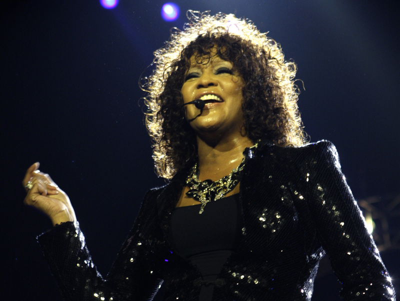 In this April 25, 2010 file photo, singer Whitney Houston performs in London. Coroner's officials said Thursday that Houston drowned, but her death was also caused by heart disease and cocaine use that suggested she was chronically using the drug. Houston died Feb. 11 in California at the age of 48.