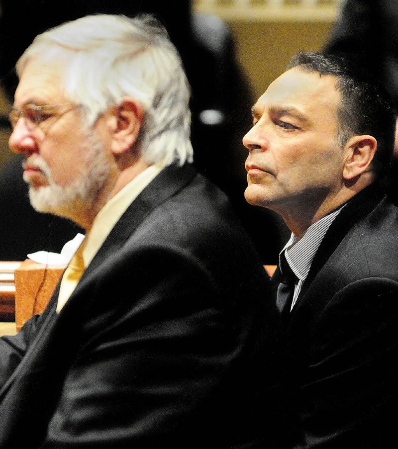 LISTENING TO THE VERDICT: Defense attorney Andrews Campbell, left, and Raymond Bellavance Jr. listen to the verdict after a jury found Bellavance guilty of two charges of arson related to a June 3, 2009, fire that destroyed the Grand View Topless Coffee Shop in Vassalboro. The verdict came on Dec. 30 after about five hours of deliberation on the 10th day of Bellavance's trial in Kennebec County Superior Court in Augusta.