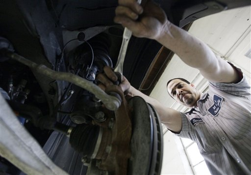 In this March 2, 2012 photo, Javier Soto works on a brake assembly at M&A Auto Body shop in Chicago. U.S. companies added 227,000 jobs in February, completing the three best months of hiring since the Great Recession began. (AP Photo/Nam Y. Huh)