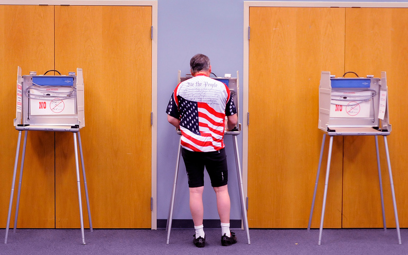 Robert Jewell who is a ''bicycle commuter'' votes in the Illinois primary election at the Bourbonnais Municipal Center in Bourgonnais, Ill., this morning.