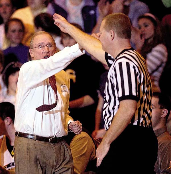 In this 2007 photo, Jim Bessey, then-coach at Mount Blue, signals for possession of the ball during a game in Farmington on his way to his 400th career victory.