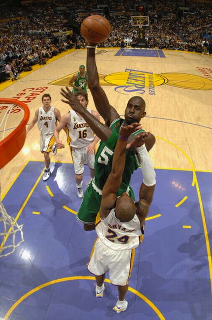 Boston Celtics forward Kevin Garnett dunks over Los Angeles Lakers guard Kobe Bryant. The Celtics and Lakers renew their historic rivalry today at 3:30 p.m.