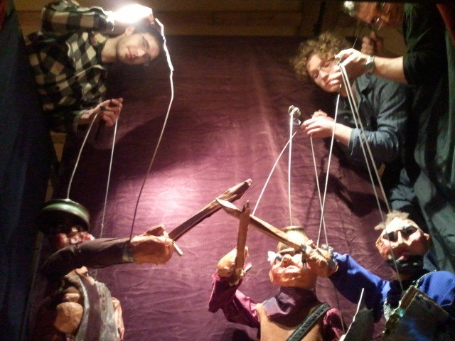 "Shoestring Theater puppeteers maneuver some of the Sicilian-style marionettes used in ""The Odyssey."" The four-part show has a cast of 30 marionettes operated by four puppeteers."
