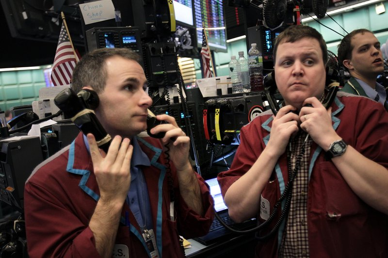Traders work in the energy options pit at the New York Mercantile Exchange in New York on Wednesday. Retail gasoline prices rose for the 22nd consecutive day to a national average of $3.73 per gallon.