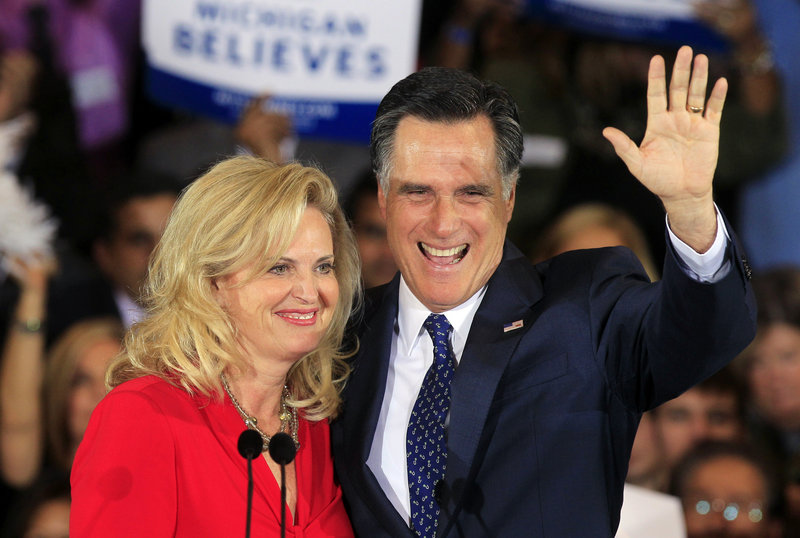 Former Massachusetts Gov. Mitt Romney and his wife Ann greet supporters Tuesday in Novi, Mich. After winning in Michigan, he looks to Ohio and other primaries next Tuesday.