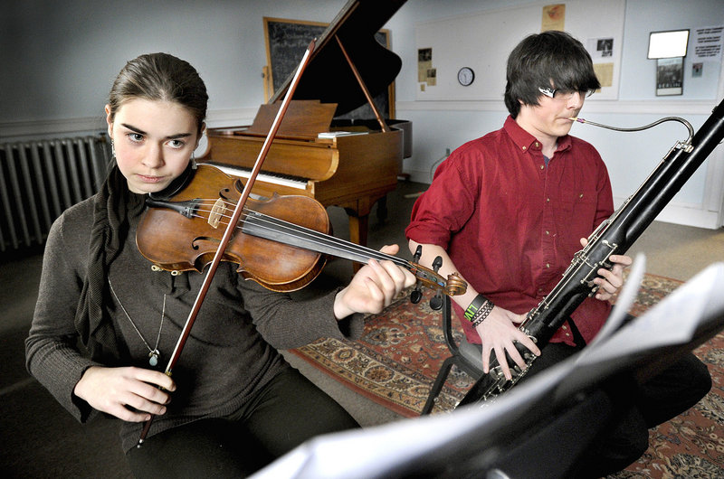 Elise LeBihan, violin, and Devin Adams, bassoon, rehearse during a recent Saturday session at the conservatory.