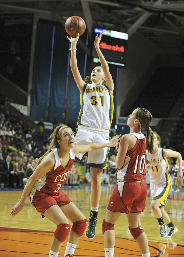 Olivia Smith, a sophomore who scored a game-high 15 points for McAuley in its 54-41 victory against Cony in the Class A final, finds room in the lane to loft a short jumper.