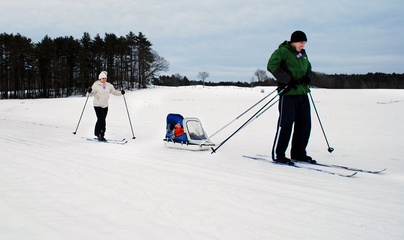 Brenda and Matt Ciardiello of Portland give their son, Roman, a taste of winter in Maine. The Ciardiellos had been waiting for a chance to learn how to cross-country ski since moving to Maine from Texas last year.