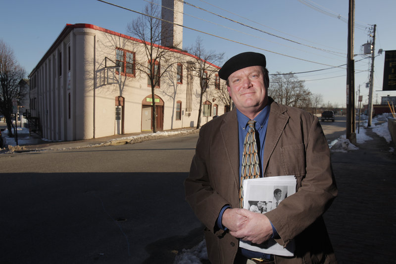 John Jaques heads the nonprofit group that hopes to open the Baxter School of Science and Mathematics at 54 York St. in Portland, shown behind him. He believes the school can open this fall, even if it doesn't receive approval until July 1.