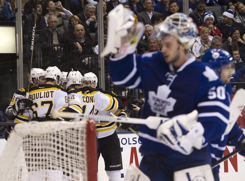 The Bruins celebrate a first-period goal Tuesday night as Leafs goalie Jonas Gustavsson looks away. The Bruins won 5-4 in Toronto to go 5-0 against the Leafs this season, outscoring them 28-10.