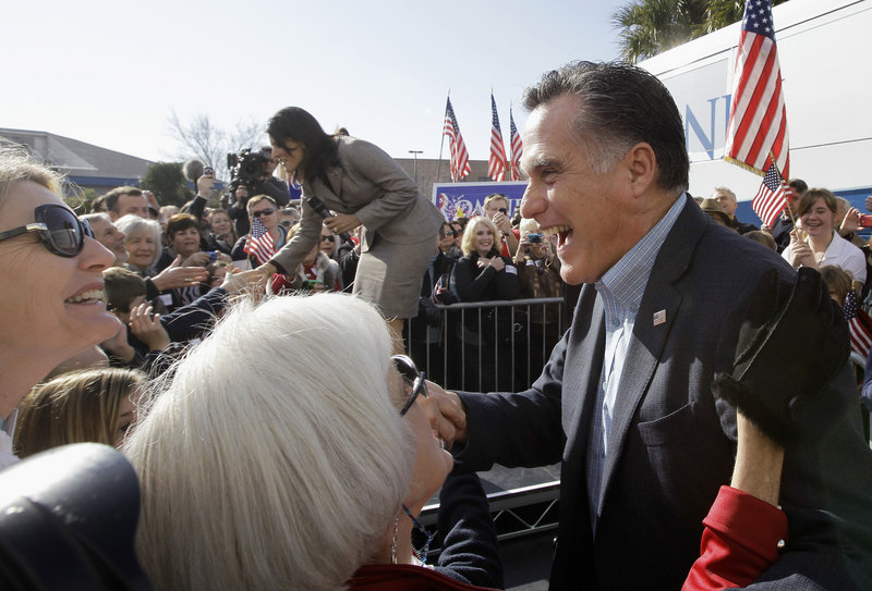 Republican presidential candidate former Massachusetts Gov. Mitt Romney campaigns in Charleston, S.C., in January. Romney faces a tough sell in the Deep South. With Mississippi and Alabama primaries coming up Tuesday, there's concern voters think he's too slick.