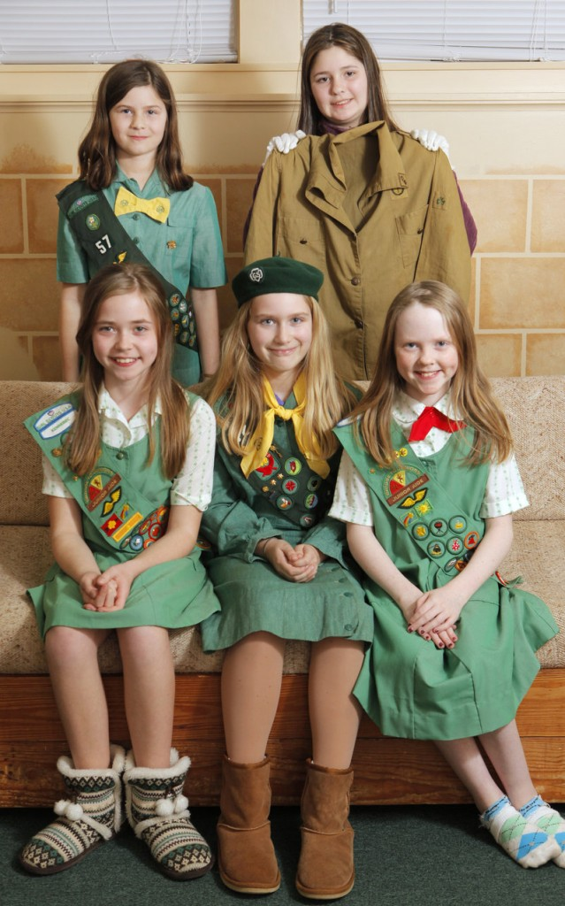 Girl Scouts in Troop 42 from Cumberland and North Yarmouth model Girl Scout uniforms from different decades at the Cumberland Congregational Church last week. Front row, left to right: Madison Weatherbee, Isabella Chandler and Kylie Josephson. Back row, left to right: Abigail Cloutier and Hannah Craig.