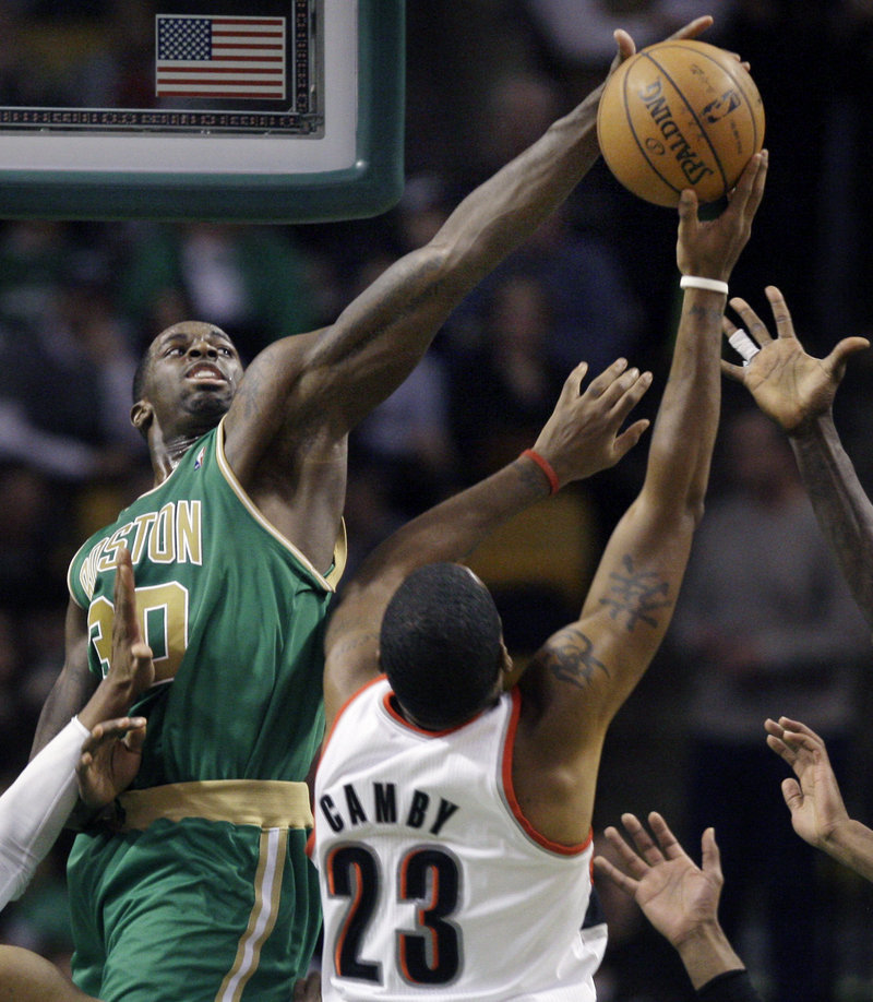 Brandon Bass of the Celtics blocks a shot by Portland Trail Blazers center Marcus Camby during the second half of their game in Boston Friday.