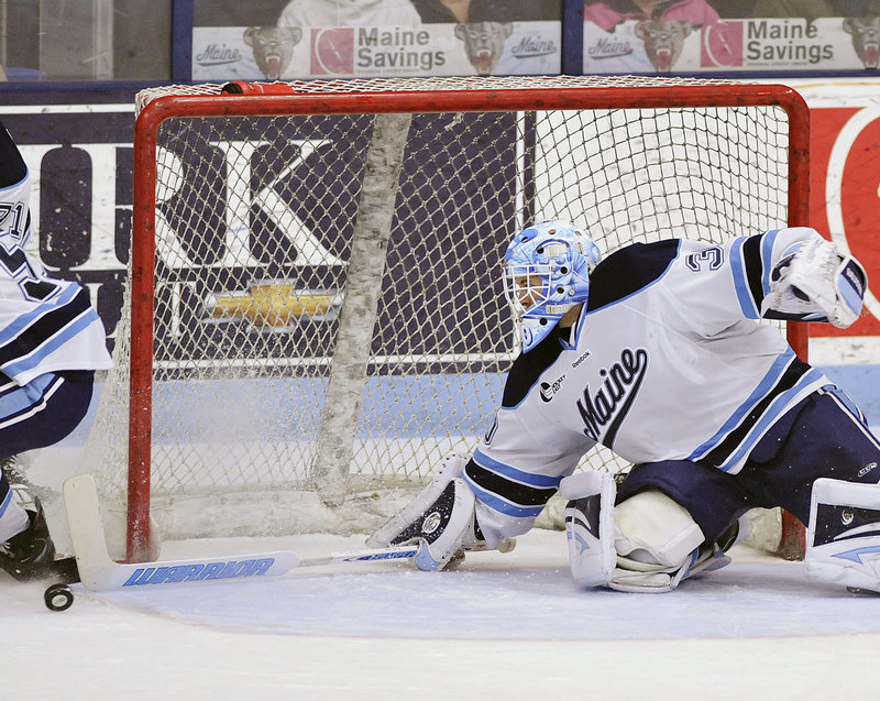 Dan Sullivan makes a stick save as the puck rolls toward the net during Sunday's game at Alfond Arena. UMaine is trying to reach the NCAA tourney for the first time since 2007.