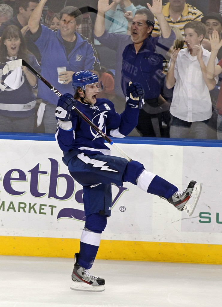 Tampa Bay's Steven Stamkos celebrates his 50th goal, in the third period Tuesday night in Tampa, Fla. Stamkos scored twice in a 6-1 win over Boston.