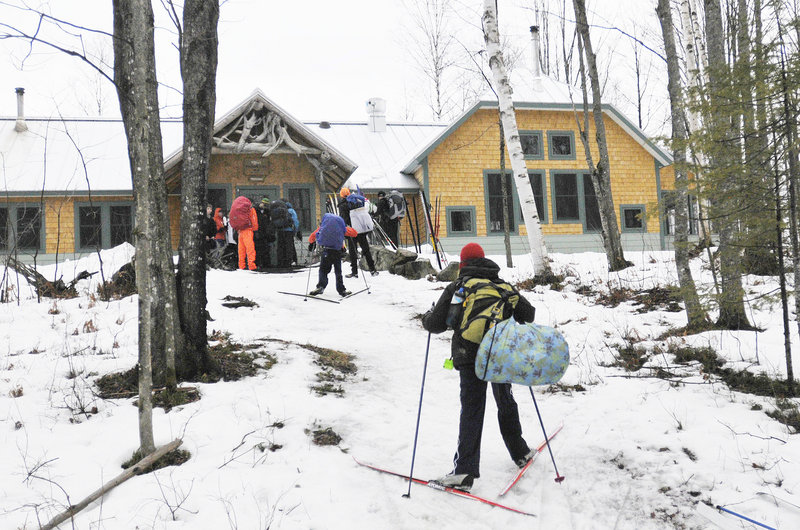 A group of students from North Yarmouth Academy arrives at the Flagstaff Lake Hut while skiing the Maine Huts & Trails system. Visitors have arrived from nearly every state and from as far as Dubai.