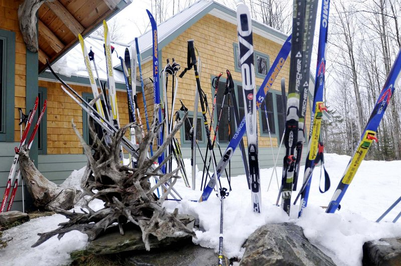 Skis and driftwood line the walkway outside the Flagstaff Lake Hut.