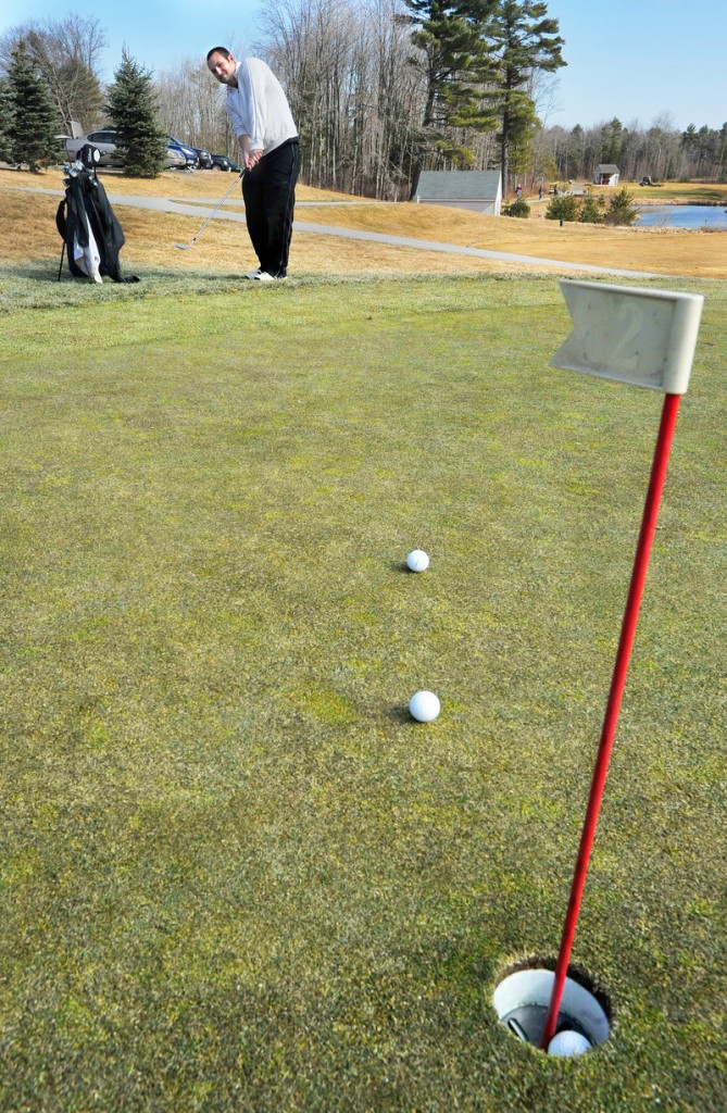 Seth Francis of Portland works on his short game Thursday at Nonesuch River Golf Club in Scarborough. Across southern Maine, the golf season has started early.