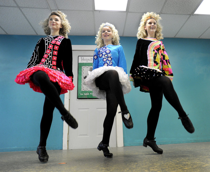 Southern Maine step dancers Deireann Stillson, Emma Fitzpatrick and Ciara Stillson practice their moves at the Stillson School of Irish Dance on Warren Avenue in Portland this week. They will join thousands of dancers from across the globe to compete in the World Championships of Irish Dancing in Belfast, Northern Ireland, this month.