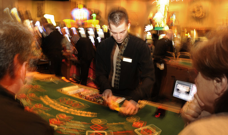 Shawn Hollobaugh deals cards in a game of three-card poker at the Hollywood Casino Hotel & Raceway in Bangor on Friday morning.