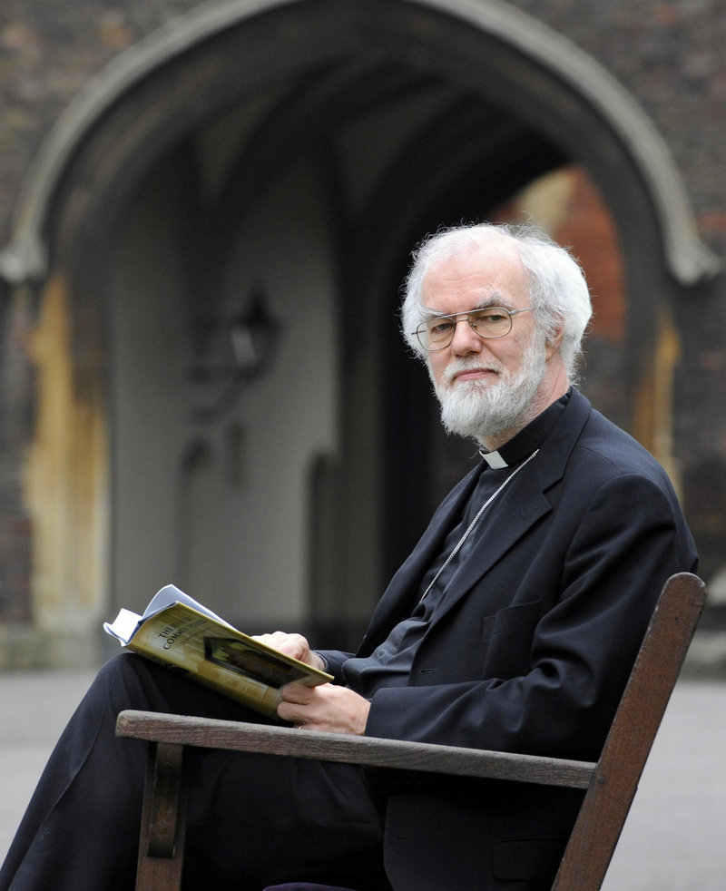 Archbishop of Canterbury Rowan Williams reads the Book of Common Prayer at Lambeth Palace in London on Friday. Williams says he is stepping down at the end of the year.
