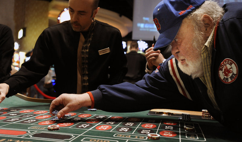 Gerry Beckwith of Hampden places a bet at the roulette table at Hollywood Casino Hotel & Raceway in Bangor on Friday morning.